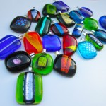 bunch of pendants of various colours and shapes