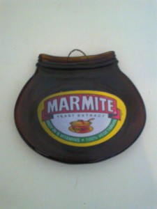 flattened Marmite jar to hang on the wall