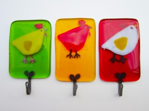 Glass tea towel holders with colourful chicken design