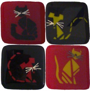 set of four coasters with cats and mice design