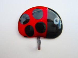 Glass tea towel holders with colourful ladybird design