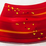 Centerpiece for dinner table with red and yellow motif