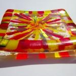 small decorative dish with sun design