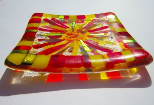 small decorative dish with sun design