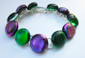 bracelet with alternate dichroic and glass cabochons
