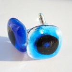 turquoise cufflinks with dichroic black and blue centre